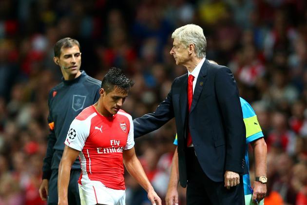 Wenger Expects Ozil, Sanchez To Face Chelsea, Hails Hiddink