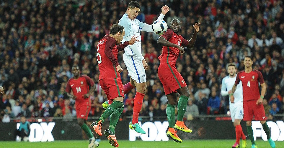 Smalling Scores As England Edge 10-Man Portugal