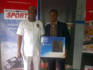 L - R Solomon Ojeagbase (Senior Manager IT/ Marketing Executive) with prize winner Aifuwa Emmanuel